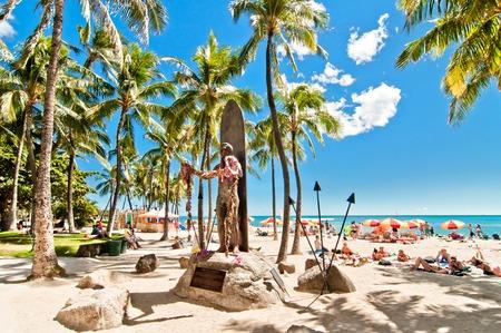 WAIKIKI, HAWAII - SEPTEMBER 7, 2013  Tourists sunbathing and surfing on Waikiki beach in Honolulu, Hawaii  Waikiki white sand beach shoreline is Hawaii s most famous beach  Editorial