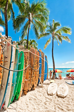 HONOLULU, HAWAII - SEPTEMBER 7, 2013  Surfboards lined up in the rack at famous Waikiki Beach in Honolulu  Oahu, Hawaii