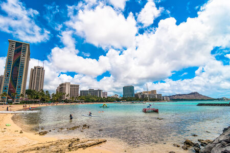 WAIKIKI, HAWAII - SEPTEMBER 7, 2013  Waikiki shoreline with hotels and Diamond Head in Honolulu, Hawaii  Waikiki white sand beach shoreline is Hawaii s most famous beach  Editorial