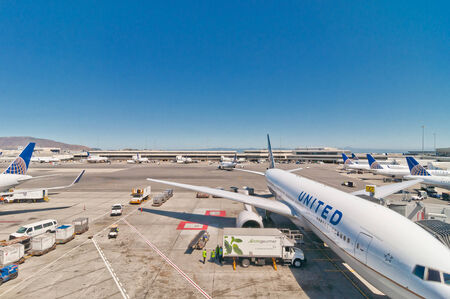 company merger: SAN FRANCISCO, USA - SEPTEMBER 8, 2013  United Airline Boeing 767-322 at San Francisco International Airport in San Francisco, USA  Since its merger with Continental Airlines the company boasts more revenue passenger miles than any airline in the world