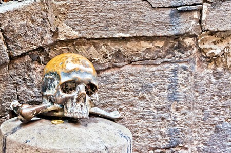 skull on the outside wall of Santa Maria delle Anime del Purgatorio Church in Naples, Italy