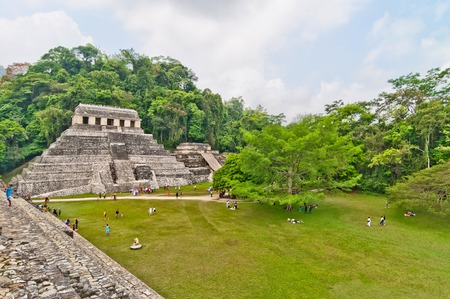 PALENQUE, MEXICO - APRIL 18,2014  tourists visit Palenque ruins in Chiapas, Mexico  Palenque was a Maya city state in southern Mexico that flourished in the 7th century