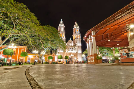 CAMPECHE, MEXICO - APRIL 19,2014  night view of main square and Cathedral in Campeche, Mexico  The city was founded in 1540 by Spanish conquistadores as San Francisco de Campeche atop the pre-existing Maya city of Canpech