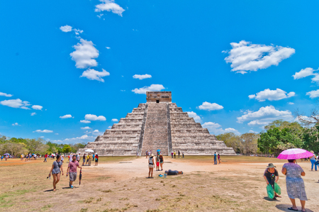 archaeological sites: CHICHEN ITZA, MEXICO - APRIL 20, 2014  Tourists visiting Chichen Itza, one of the most visited archaeological sites in Yucatan, Mexico  About 1 2 million tourists visit the ruins every year Editorial