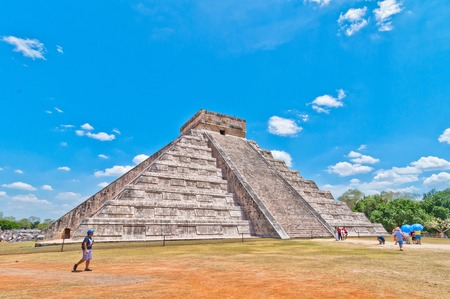 CHICHEN ITZA, MEXICO - APRIL 20, 2014  Tourists visiting Chichen Itza, one of the most visited archaeological sites in Yucatan, Mexico  About 1 2 million tourists visit the ruins every year
