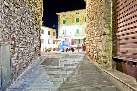 kilometres: CAMPIGLIA MARITTIMA, ITALY - FEBRUARY 18, 2014  night view of medieval street in Campiglia Marittima, Tuscany  Campiglia is a Tuscany municipality located about 90 kilometres southwest of Florence Editorial