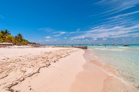 mujeres: Isla Mujeres, Mexico - April 22, 2014: tourists enjoy tropical sea on famous Playa del Norte beach in Isla Mujeres, Mexico. The island is located 8 miles northeast of Canc?n in the Caribbean Sea