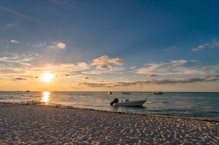 mujeres: sunset on tropical beach in Isla Mujeres, Mexico