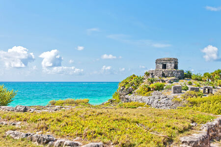 roo: God of Winds Temple guarding Tulums sea entrance bay in Quintana Roo, Mexico Stock Photo