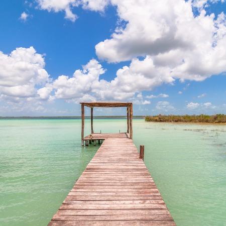 palapa: idyllic pier and palapa hut in Bacalar lagoon, Mexico Stock Photo