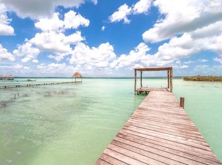 pier and palapa in Caribbean Bacalar lagoon, Quintana Roo, Mexico photo