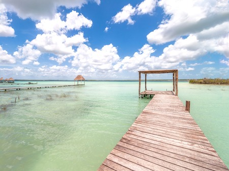 roo: pier and palapa in Caribbean Bacalar lagoon, Quintana Roo, Mexico