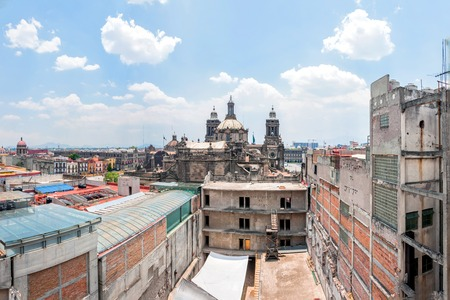 overpopulation: day view of Mexico City zocalo from roofs