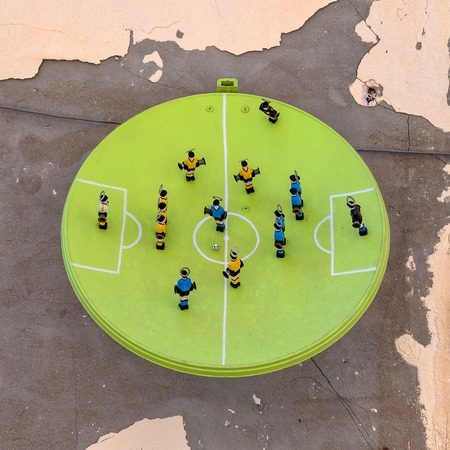 syracuse: SYRACUSE, ITALY - AUGUST 17, 2014: art installation named La parabola del calcio by Alessandro Andolina on wall in Syracuse, Italy. Ortigia is a small island which is the historical centre of the city of Syracuse, Sicily.