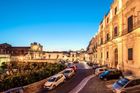 known: NOTO, ITALY - AUGUST 18, 2014: view on downtown in Noto, Italy. In 2002 Noto and its church were declared a UNESCO World Heritage Site.