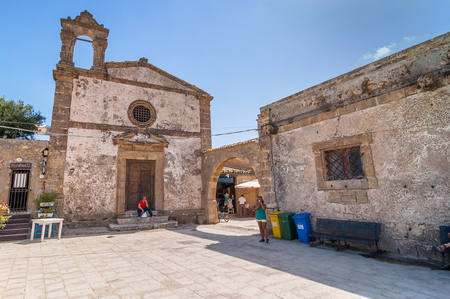 kilometres: MARZAMEMI, ITALY -  AUGUST 19, 2014: tourists visit main square in Marzamemi, Italy. It is a small fishing village just a few kilometres up the coast from Italy
