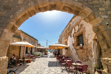 glimpse: MARZAMEMI, ITALY -  AUGUST 19, 2014: tourists visit old village in Marzamemi, Italy. It is a small fishing village close to Italy