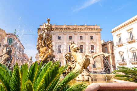 syracuse: SYRACUSE, ITALY - AUGUST 20, 2014: Artemide fountain and Archimede square in Ortigia, Syracuse, Italy. Ortigia is a small island which is the historical centre of the city of Syracuse, Sicily. Editorial