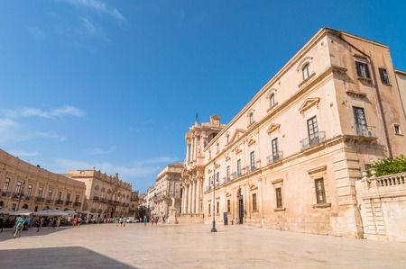 syracuse: SYRACUSE, ITALY - AUGUST 16, 2014: tourists and locals visit main square Piazza del Duomo in Ortigia, Syracuse, Italy. Ortigia is a small island which is the historical centre of the city of Syracuse, Sicily. Editorial