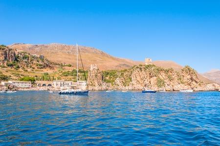 unspoilt: ZINGARO NATURAL RESERVE, ITALY - AUGUST 26, 2014: tourists enjoy blue mediterranean sea in Zingaro Natural Reserve, Italy. This National Park stretches along about 7 kilometers of unspoilt coastline