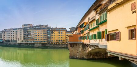 acknowledged: FLORENCE, ITALY - March 21, 2014: tourists visit famous Ponte Vecchio in Florence, Italy. Florence, acknowledged by Unesco as a World Heritage Site, is home to some of the most famous works of art on earth Editorial