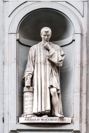 Statue of Niccol? Machiavelli in Uffizi gallery, seen in Lungarno degli Archibusieri street. Florence, Italy.
