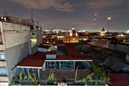 overpopulation: Mexico City, Mexico - April 29, 2014: night view of skyline with brightly lit suburban barrios in the background in Mexico City, Mexico. The city is located at an altitude of 2,240 metres Editorial