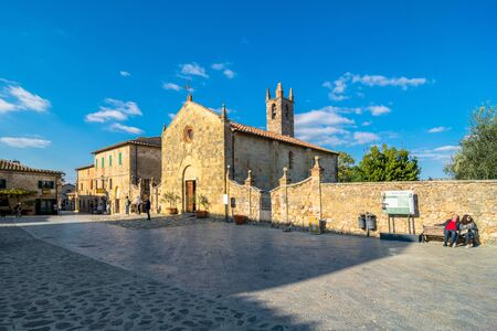 walled: MONTERIGGIONI ITALY  October 26 2014: tourists visit main square in Monteriggioni Siena Italy. Monteriggioni is a medieval walled town located on a natural hillock. Editorial
