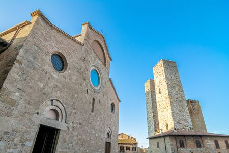 declared: SAN GIMIGNANO  October 26 2014: street view with skyline in San Gimignano Italy. The historic centre of San Gimignano has been declared by UNESCO a World Heritage Site.