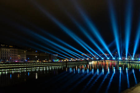origins: LYON, FRANCE - DECEMBER 6, 2014: street view with city skyline during Festival of Lights in Lyon, France. The origins of the Fete des Lumieres date to 1643.