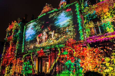 origins: LYON FRANCE  DECEMBER 6 2014: street view of Festival of Lights in Lyon France. The origins of this festival named Fete des Lumieres date to 1643. Editorial