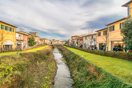 overspending: BARBERINO DI MUGELLO, ITALY - January 24, 2015: tourists shop at McArthurGlen Designer Outlet in Barberino di Mugello, Italy. Designer Outlet are located across Europe and offer discounts and special promotions Editorial