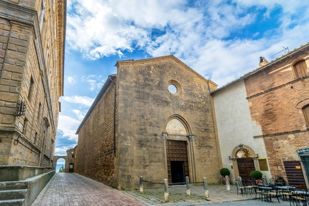 pienza: PIENZA, ITALY - January 25, 2015: Street view of historic center and Val dOrcia valley in Pienza, Italy. In 2004 the Val dOrcia was added to the UNESCO list of World Heritage Sites.
