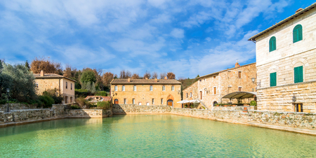 orcia: BAGNO VIGNONI, ITALY - January 25, 2015: old thermal baths in the heart of medieval village in Bagno Vignoni, Italy.  In 2004 Bagno Vignoni was added to the UNESCO list of World Heritage Sites.