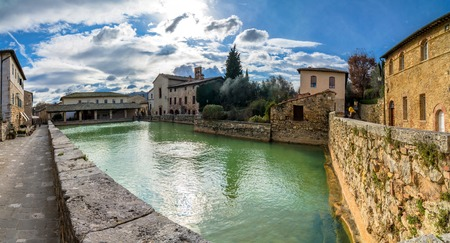 a bathing place: BAGNO VIGNONI, ITALY - January 25, 2015: old thermal baths in the heart of medieval village in Bagno Vignoni, Italy.  In 2004 Bagno Vignoni was added to the UNESCO list of World Heritage Sites.