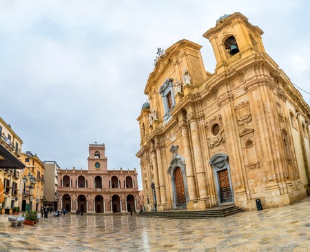 dated: MARSALA, ITALY - FEBRUARY 22, 2015: day view of main square and Cathedral in Marsala, Italy. Marsala Cathedral, started in 1628, was built on a Norman implant dated to 1176. Editorial