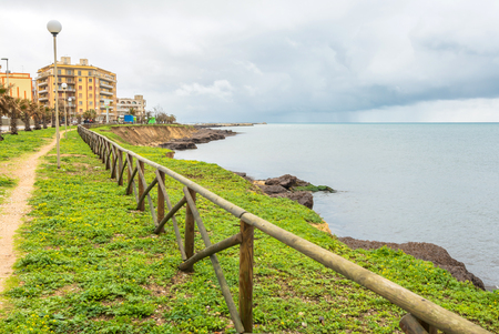 MARSALA, ITALY - FEBRUARY 22, 2014: day view of coastline and mediterranean sea with dramatic sky in Marsala, Italy. The town is famous for the docking of Garibaldi on 11 May 1860 and for its wine.