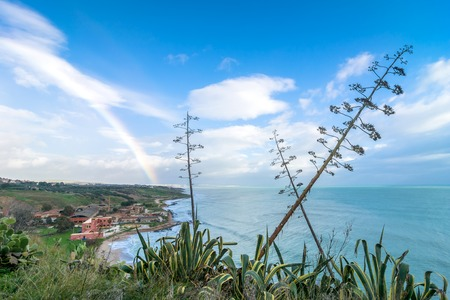 domination: SCIACCA, ITALY - FEBRUARY 22, 2014: panoramic view of coastline with dramatic sky in Sciacca, Italy. Sciacca is known as the city of thermal baths since Greek domination in the 3rd and 4th centuries BC Editorial