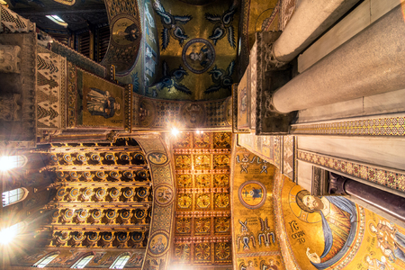 extant: MONREALE, ITALY - FEBRUARY 24, 2014: interior view of famous Santa Maria Nuova cathedral in Monreale, Italy. The Cathedral of Monreale is one of the greatest extant examples of Norman architecture in the world