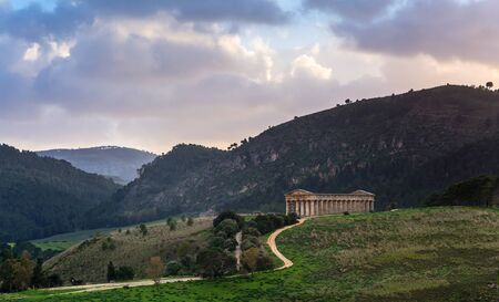 segesta: Landscape and doric temple at sunset in Segesta archaeological area, Sicily Stock Photo