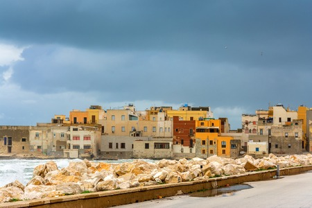 egadi: TRAPANI, ITALY - FEBRUARY 25, 2014: day view of harbor and waterfront in Trapani, Italy. The city is an important fishing port and the main gateway to the nearby Egadi Islands Editorial