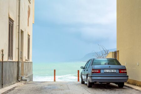 egadi: TRAPANI, ITALY - FEBRUARY 25, 2014: day view of street and waterfront in Trapani, Italy. The city is an important fishing port and the main gateway to the nearby Egadi Islands. Editorial