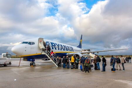 trapani: TRAPANI, ITALY - FEBRUARY 25, 2014: passengers boarding Ryanair Jet airplane in Trapani airport, Italy. Ryanair is the biggest low-cost airline company in the world.