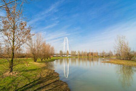 reggio emilia: REGGIO EMILIA, ITALY - MARCH 9, 2015: bridges complex by architect Santiago Calatrava reflected in pound in Reggio Emilia, Italy. The central arch of the bridge is 220 meters long and 50 meters high