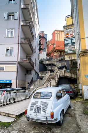 potenza: POTENZA, ITALY - MARCH 13, 2015: day view of downtown street and old FIAT 600 car in Potenza, Italy. Potenza is the highest regional capital city in Italy.