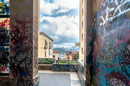 potenza: POTENZA, ITALY - MARCH 13, 2015: vandalized  urban wall with  tags and graffiti in Potenza, Italy. Potenza is the highest regional capital city in Italy. Editorial