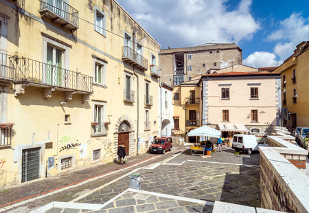 potenza: POTENZA, ITALY - MARCH 13, 2015: day view of downtown street and local people in Potenza, Italy. Potenza is the highest regional capital city in Italy.