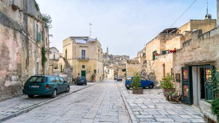 unesco culture heritage: MATERA, ITALY - MAY 15, 2015: street view with cars of Sassi di Matera ancient town in Matera, Italy. The city is a UNESCO World Heritage site and European Capital of Culture for 2019.