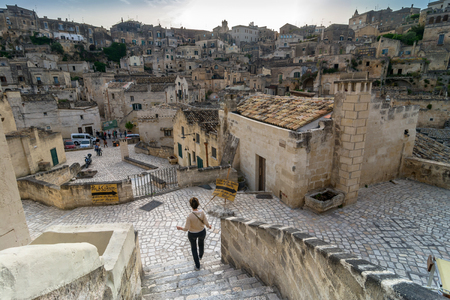 unesco culture heritage: MATERA, ITALY - MAY 15, 2015: street view of Sassi di Matera ancient town with tourists in Matera, Italy. The city is a UNESCO World Heritage site and European Capital of Culture for 2019.