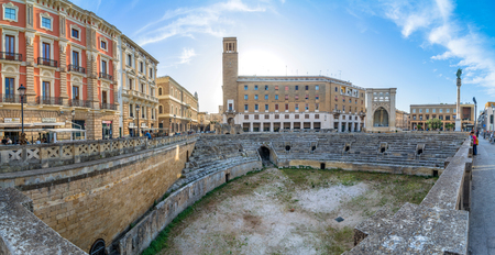LECCE, ITALY - MAY 16, 2015: street view of Roman Amphiteatre in Sant Oronzo square in Lecce, Italy. Built in the 2nd century, this theatre was able to seat more than 25,000 people.